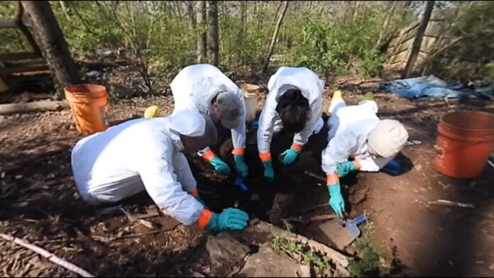 Forensics experts at the scene of the discovery at the River Stour in Sudbury one year ago - Credit: Archant